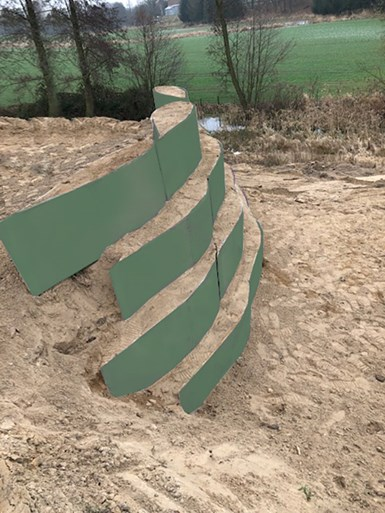 geotechnical road blocks made with repurposed composite wind blades