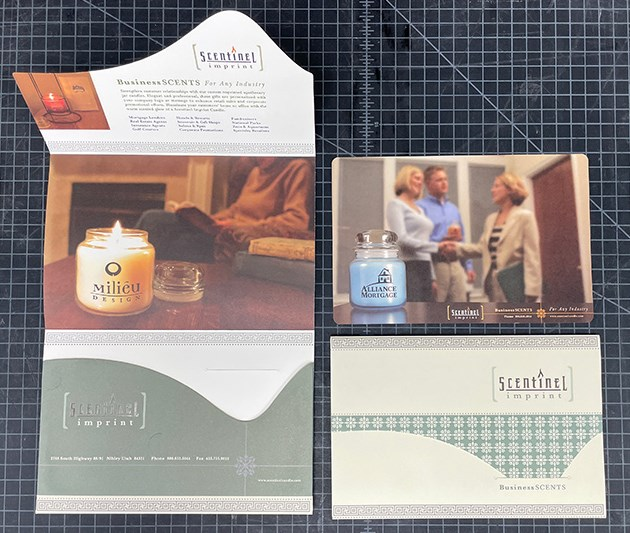 This client take-away was designed with a custom die-cut envelope, foil stamp logo and printed using metallic inks.
