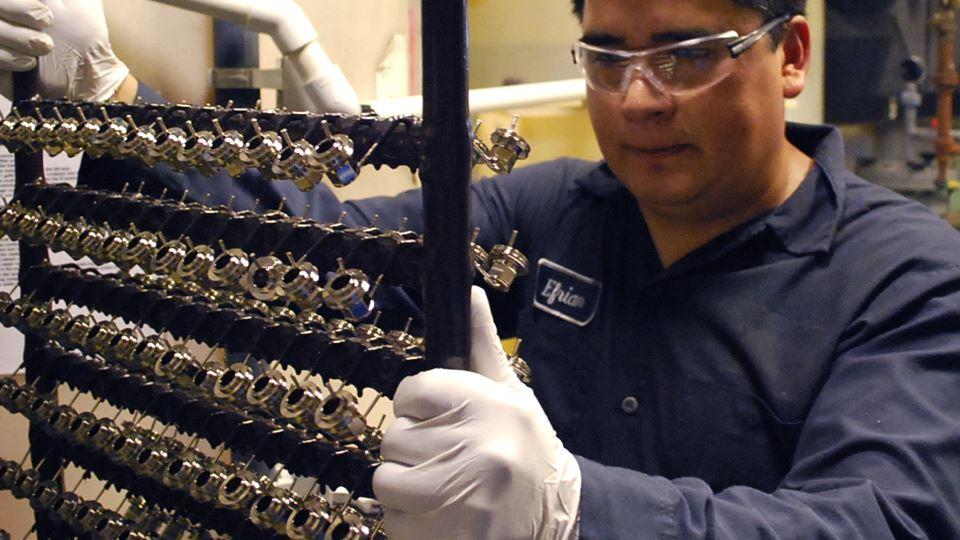 Man examining freshly finished parts.