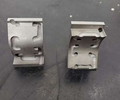 Este es un inserto con refrigeración en serpentín fabricado en la máquina Farsoon de APM. Se cortó con electroerosión por hilo para poder apreciar el canal interno.