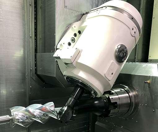 Las herramientas de forma y sujeción de trabajo personalizadas le permiten a Whipple Superchargers fresar con precisión los rotores de los supercargadores en un solo alistamiento en un torno-fresador con eje B.