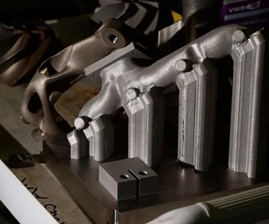 Una mesa contiene piezas de metal creadas por una impresora 3D en el Laboratorio de Investigación del Ejército en Aberdeen Proving Ground, en Maryland. (Foto: EJ Hersom– Army.mil)