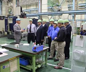 Robb Hudson, CEO, Mitsui Seiki (U.S.A.) Inc. and a group of visitors at Mitsui Seiki's Japan machine tool factory