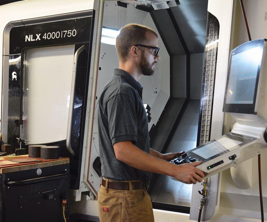 man at a machine tool CNC