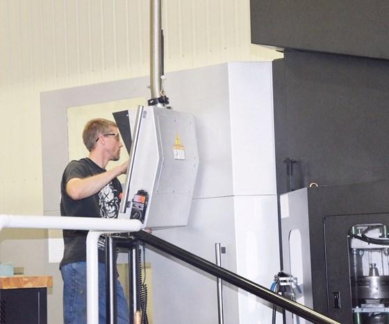 Chris Behnfeldt operating the Toyoda machine