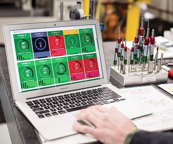 a machine monitoring dashboard on a MacBook