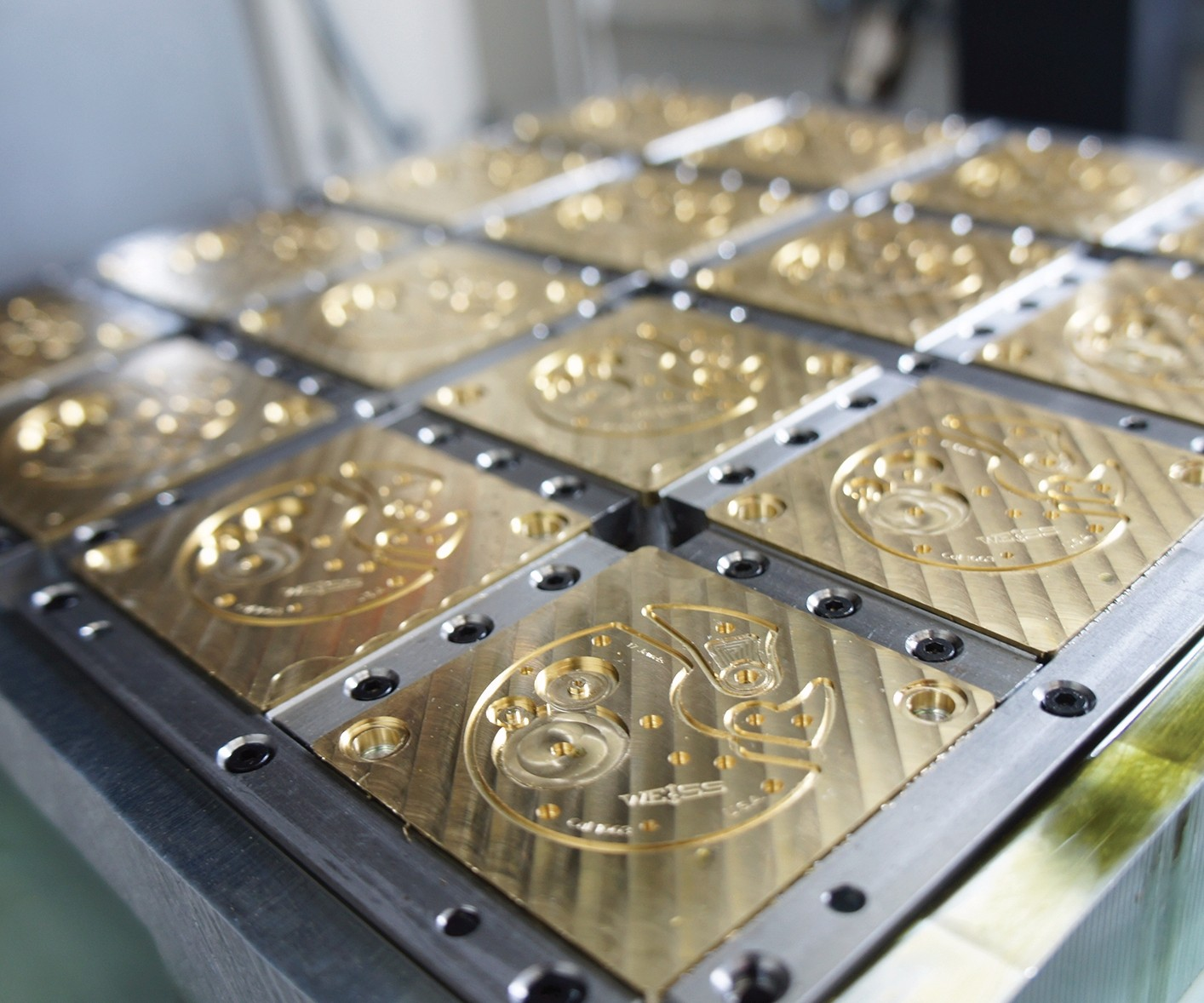 brass bridge workpieces after profile machining in a 16-station custom fixture