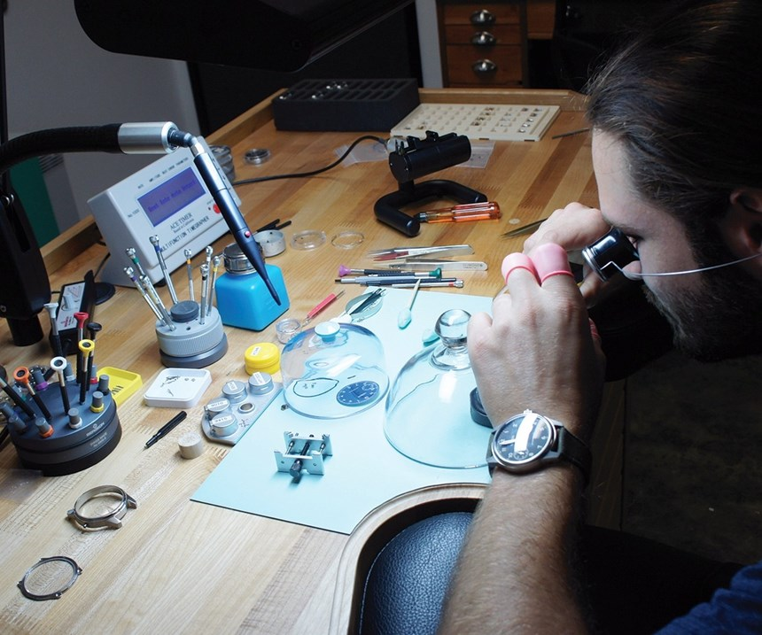 Cameron Weiss assembles a watch with machined hand tools