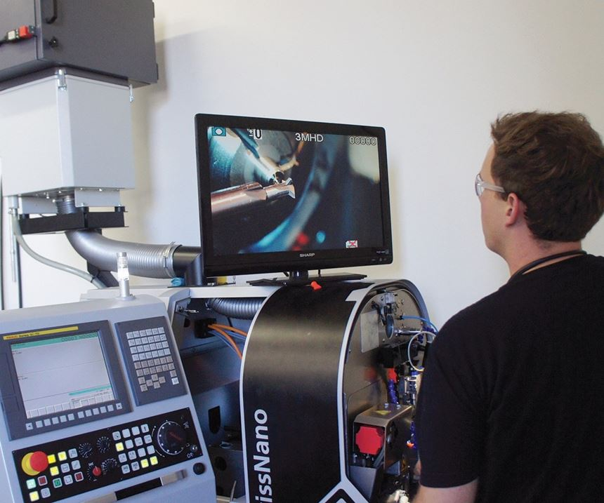 Grant Hughson, a machinist, watching his work on a screen