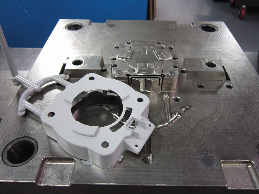 a plastic part with its machined mold