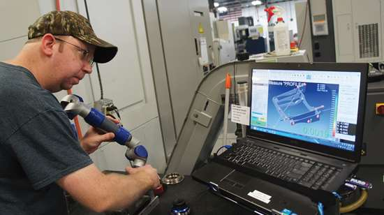 Justin Patry uses a portable CMM