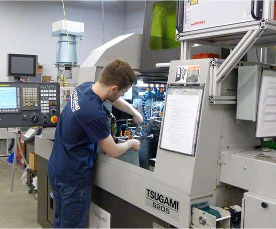 Eric Olander operates a LaserSwiss machine