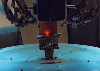 Guyson multi-axis CNC grit blaster