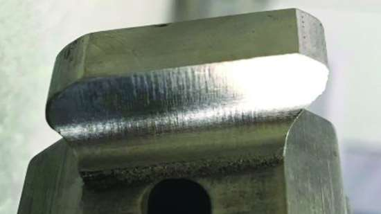 Turbine blade root form with 3D-printed feature after machining