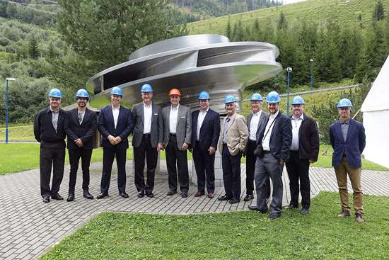 tour group in front of one the Dlouhé Stráně plant's 325-W turbines