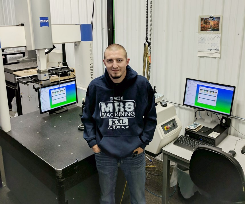 Former high school football player working with MRS Machining coordinate measuring machine