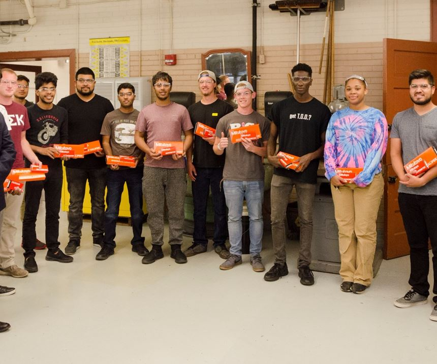 students of NIU's engineering college stand with their donated Mitutoyo instruments