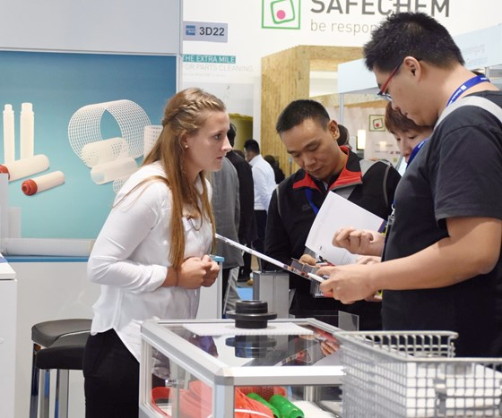 attendees at a parts2clean booth