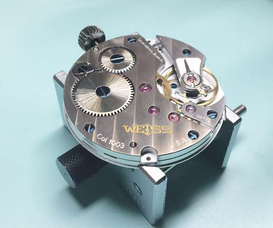 CAL 1003 movement (the engine that drives a mechanical watch)