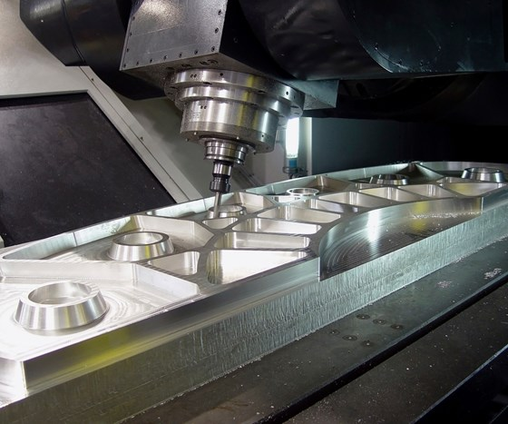 a five-axis machine milling a large part