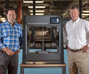 Ric Fulop and Brad Morris with Desktop Metal's Studio System 3D printer