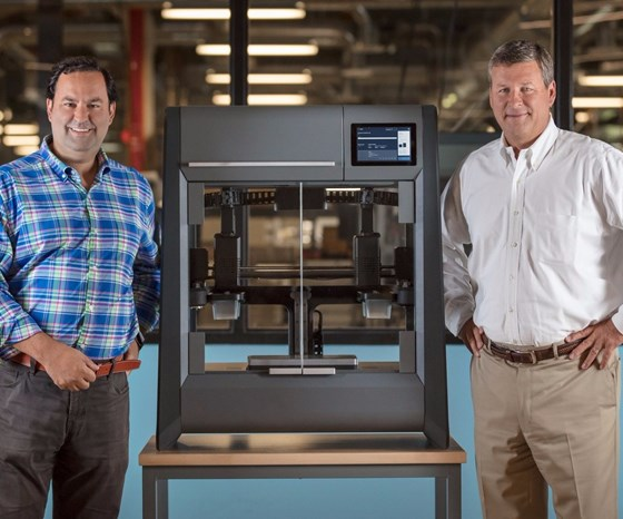 Ric Fulop and Brad Morris with Desktop Metal's Studio System 3D printer