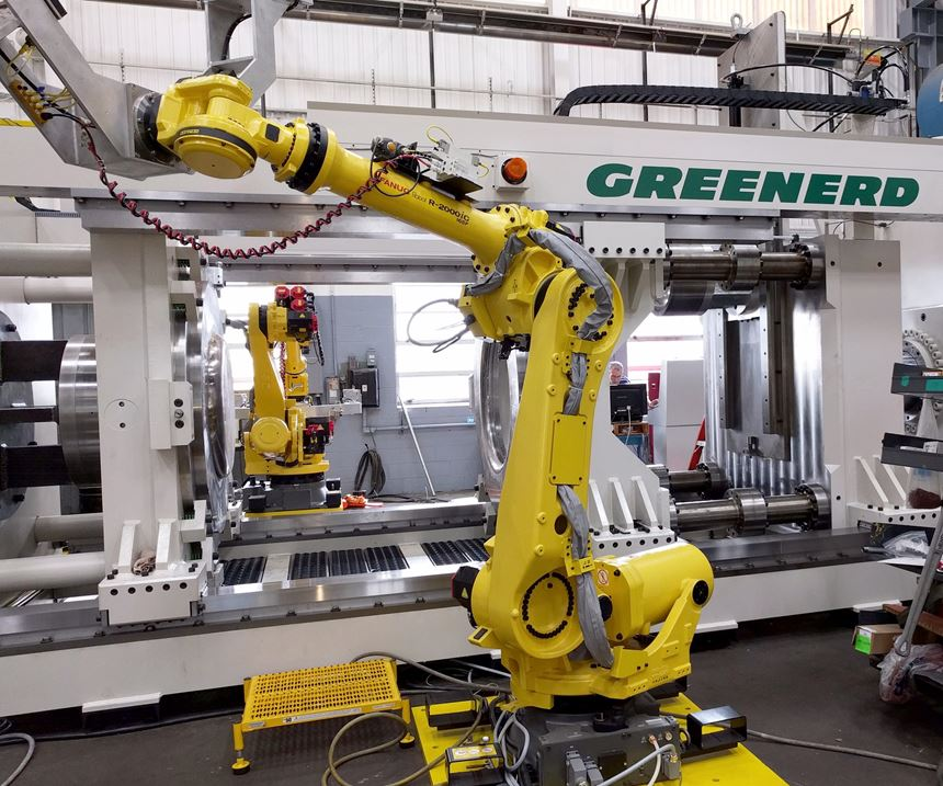 A FANUC robot with a Greenerd hydraulic press