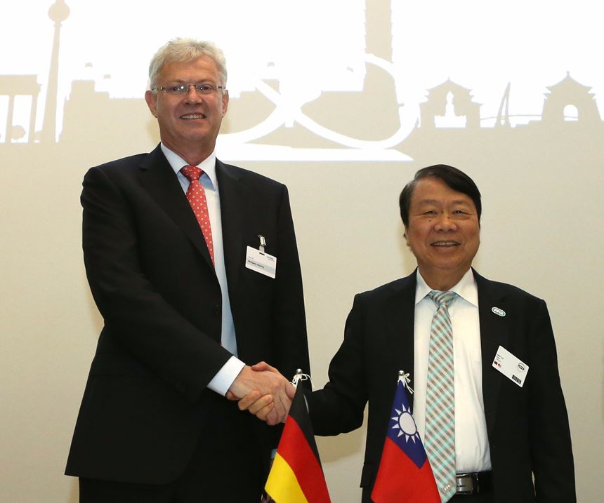 Dr. Wolfgang Heuring shakes hands with Dr. Jimmy Chu