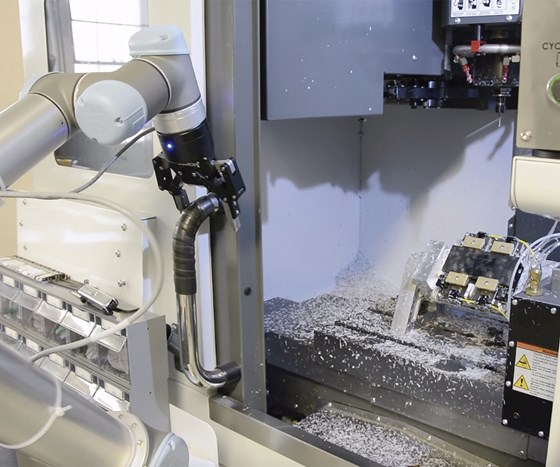 robot opening the door of a machining center