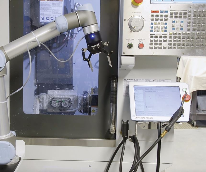 robot beside a machining center