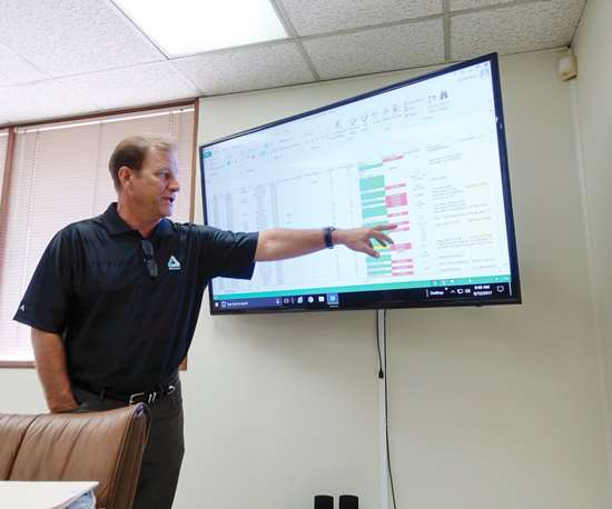 President John Bloom points at an ERP screen