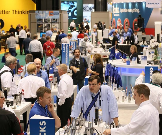 Attendees meet and mingle on the show floor at IMTS.