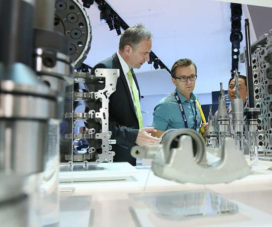 Attendees analyze new technology on the show floor at the International Manufacturing Technology Show (IMTS).