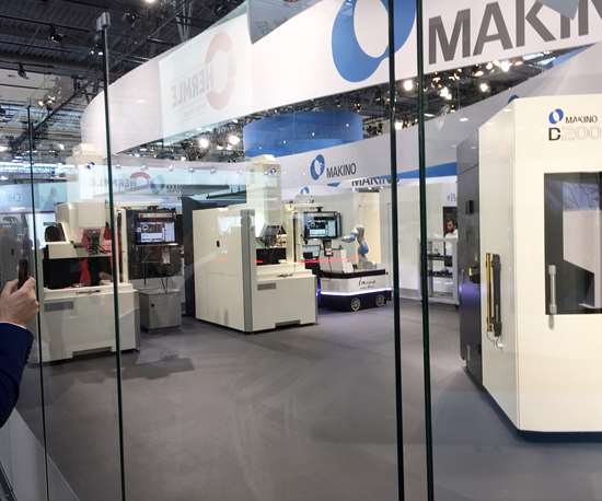 the iAssist mobile robot serving a machine tool at Makino's booth