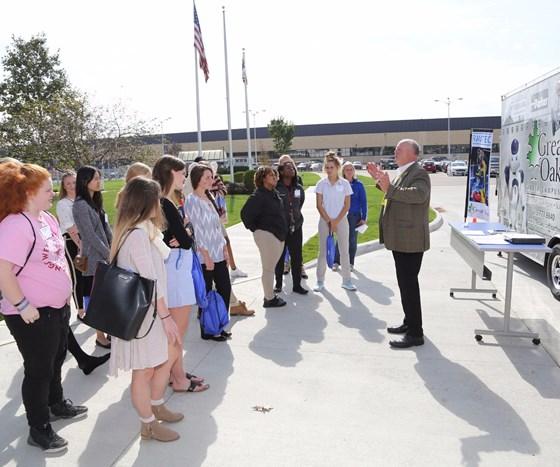 students in front of Great Oaks Vocational School's robotics trailer