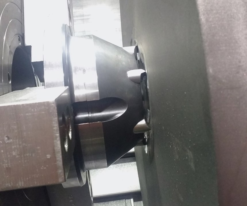 Face driver holding a large flanged shaft component