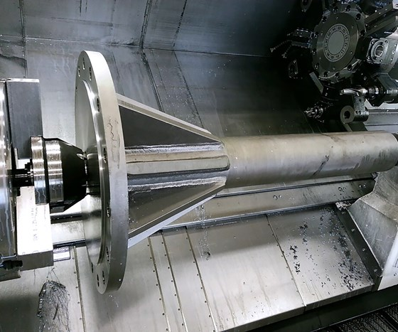 Large flanged shaft being held by a face driver