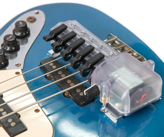 The Gizmotron 2.0 mounted on a bass guitar.