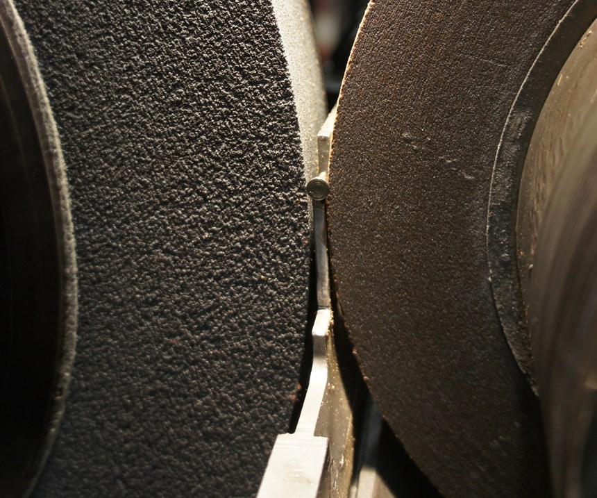 A part undergoes centerless grinding on the shop's Cincinnati Cinco machine.
