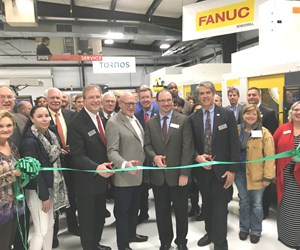 Methods Machine Tools representatives and others gather for a ribbon-cutting ceremony to open the company's new technical center in Memphis, TN.