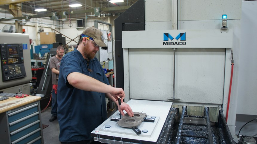NAME, TITLE sets up a component for a cast assembly on one of pallet while another part is being machined on one of the shop's horizontal machining centers.