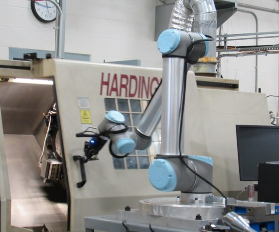 collaborative robot opening the door for a CNC lathe