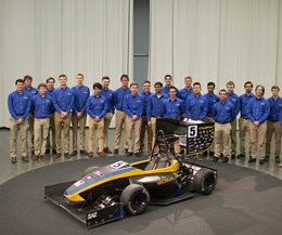 Engineering students from the University of Michigan and The Ohio State University show off Formula 1 assemblies at KyoceraSGS Precision Tools' IMTS booth 432217.