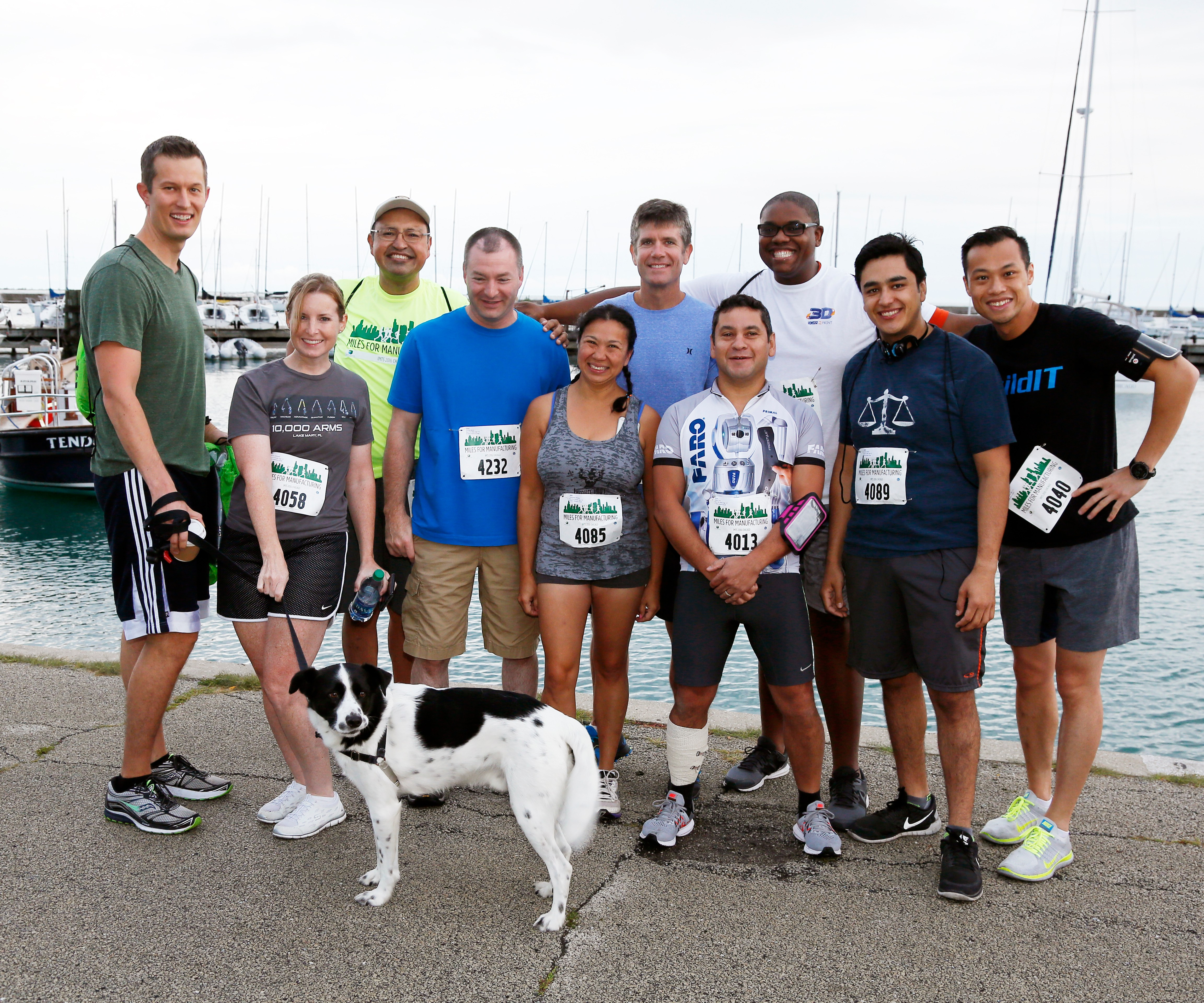 Runners posing before Miles for Manufacturing 5K