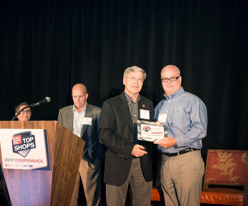 Mark Albert awards Top Shop honoree