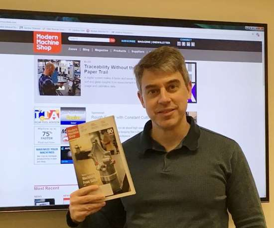 Peter Zelinski holding January issue of Modern Machine Shop