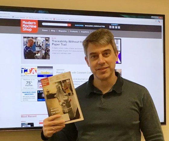 Peter Zelinski holding January issue of Modern Machine Shop