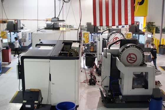 A sweeping shot of a bright, clean and organized machine shop floor