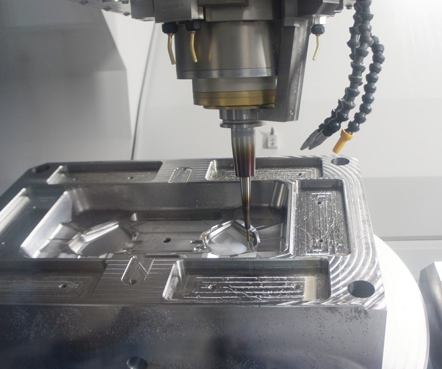 Meta: A closer look at the five-axis Roders RXU 1001 DSH machining center carving plastic injection mold features.