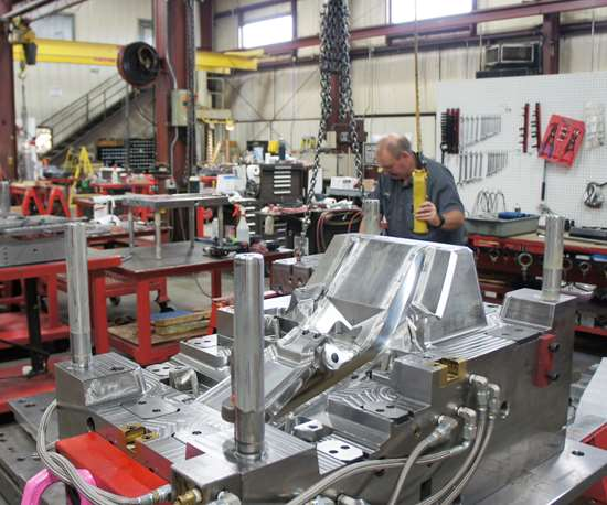A complex plastic injection molds awaits further operations on the shop floor at Precise Tooling Solutions, which has a particular specialty automotive interior and lighting tools.